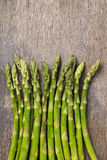 Bunch of fresh green asparagus on old wood board Royalty Free Stock Image