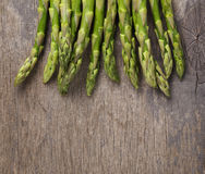 Bunch of fresh green asparagus on old wood board Stock Photo