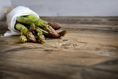Bunch of fresh green asparagus over dark wooden table Royalty Free Stock Photography
