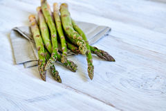 Bunch of fresh green asparagus over white wooden table Royalty Free Stock Image