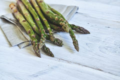 Bunch of fresh green asparagus over white wooden table Royalty Free Stock Photo