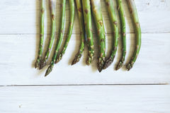 Bunch of fresh green asparagus over white wooden table Royalty Free Stock Photography