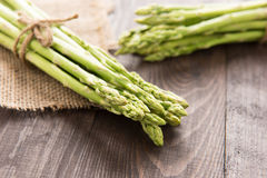 Bunch of fresh green asparagus on a rustic wooden table Stock Photography