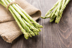 Bunch of fresh green asparagus on a rustic wooden table Stock Photo