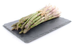 Bunch of fresh green asparagus on a slate tray Royalty Free Stock Images