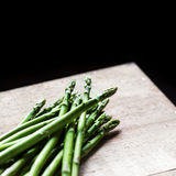 Bunch of fresh green asparagus spears  on a rustic wooden table Stock Image