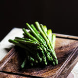 Bunch of fresh green asparagus spears tied with twine on a rusti Royalty Free Stock Photography
