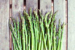 Bunch of fresh green asparagus vegetable. Bunch of fresh raw green asparagus vegetable on wooden background Royalty Free Stock Photography