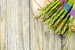 Bunch of fresh green asparagus on wooden table Royalty Free Stock Photos