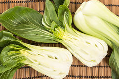 Bunch of fresh green baby bok choy , on bamboo placemat Stock Images