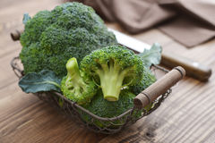 Bunch of fresh green broccoli. On wooden background closeup Royalty Free Stock Photo