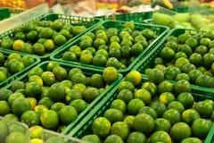 Bunch of fresh green mandarin in the organic food market. Tropical Bali island, Indonesia. Stock Images