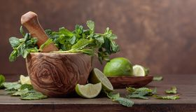 Bunch of fresh green organic mint and lime. Stock Images