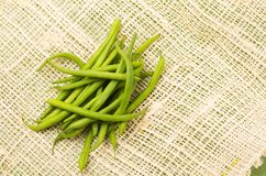 Bunch of fresh green peas placed on a rustic hemp Royalty Free Stock Photo