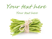 A bunch of fresh leguminous green beans on white background Stock Photography