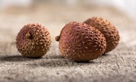 Bunch of fresh Lichi. Over old rustick background Stock Photo