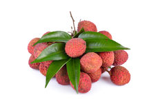 Bunch of fresh Lychees with leaves and stem on white background Stock Images