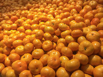 Bunch of Fresh mandarin oranges texture at the market store.selective focus. Royalty Free Stock Image