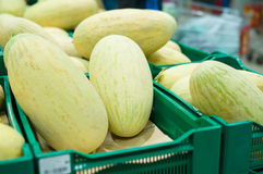 Bunch of fresh melons in supermarket Stock Images