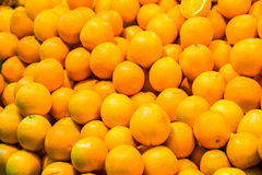 Bunch of fresh oranges for retail sale at an outdoor market. Royalty Free Stock Images