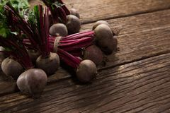 Bunch of fresh organic beetroots. On wooden table Royalty Free Stock Photography