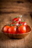 A bunch fresh organic cherry tomatoes in a bowl Royalty Free Stock Photos