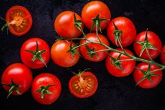A bunch of fresh organic cherry tomatoes Stock Images