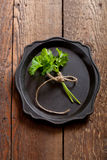 Bunch of fresh parsley on an old tray Stock Photos