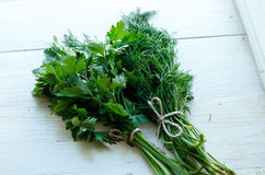 Bunch of fresh parsley on white boards. Stock Photography