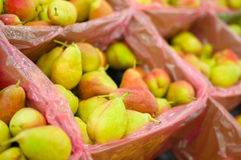 Bunch of fresh pears in boxes Stock Image