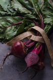 Bunch of fresh picked beetroots. On cutting board Royalty Free Stock Photos