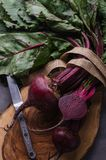 Bunch of fresh picked beetroots. On cutting board Stock Photography
