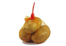 Bunch fresh potatoes in a orange mesh bag Stock Images