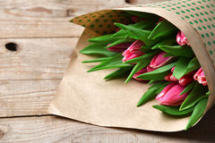 Bunch of fresh purple pink tulip flowers close up composition on Royalty Free Stock Photos