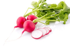Bunch fresh radish with cutting out slice isolated. On white background Stock Images