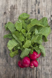 Bunch of fresh radishes. On wooden board Stock Photo
