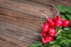 Bunch of fresh radishes on wooden table Stock Photography