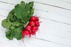 Bunch of fresh radishes on wooden table Royalty Free Stock Photography