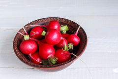 Bunch of fresh radishes on wooden table Royalty Free Stock Photos