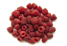 A bunch of fresh raspberries on a white background. Close-up, red berry. A bunch of fresh raspberries on a white background. Close-up, red berry Stock Photography