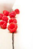 Bunch of fresh raspberry on a bowl and white table Royalty Free Stock Image