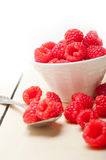 Bunch of fresh raspberry on a bowl and white table Stock Photography