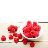 Bunch of fresh raspberry on a bowl and white table Stock Images