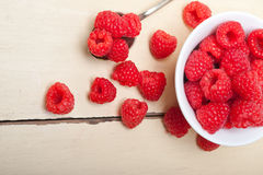 Bunch of fresh raspberry on a bowl and white table Royalty Free Stock Photography