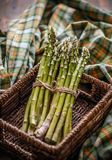 Bunch of fresh raw asparagus. In wicker basket Royalty Free Stock Image