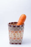 Bunch of Fresh Raw Carrot in Basket on white background Stock Photo
