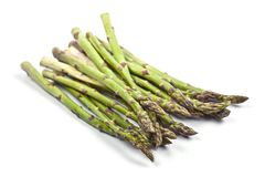 Bunch of fresh raw garden asparagus isolated on white background. Green spring vegetables royalty free stock photo