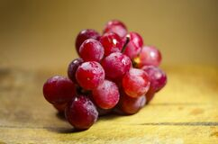 A bunch of fresh red grapes Stock Image