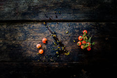 A bunch of fresh red tomatoes On the old dark wooden floor Stock Image