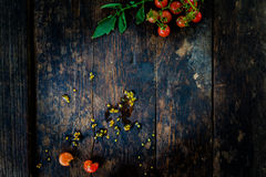 A bunch of fresh red tomatoes On the old dark wooden floor Royalty Free Stock Photo